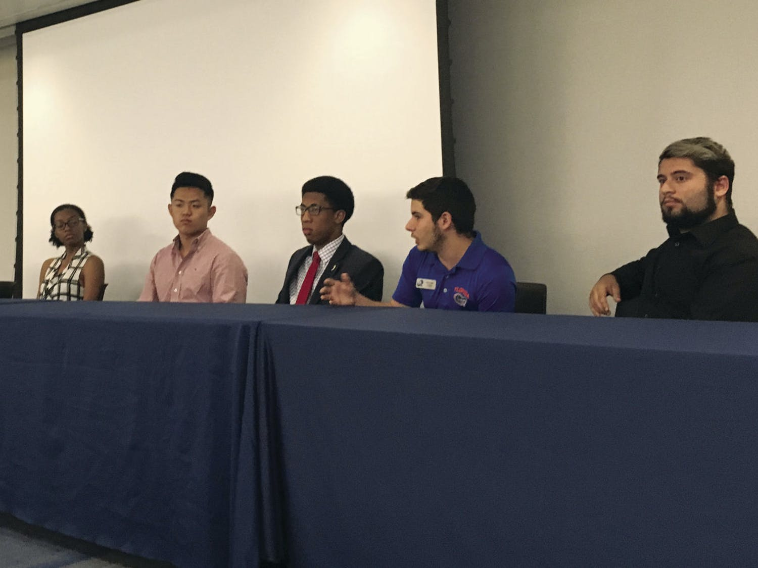 From Left: Analesa Clarke, Ronit Dastidar, Nyasha Joseph, John Kim, Ian Green, Robert Lemus and Alex Chaves discuss mental health in a panel on Tuesday. The event was during the first day of Student Government's annual Mental Health Awareness Week.
