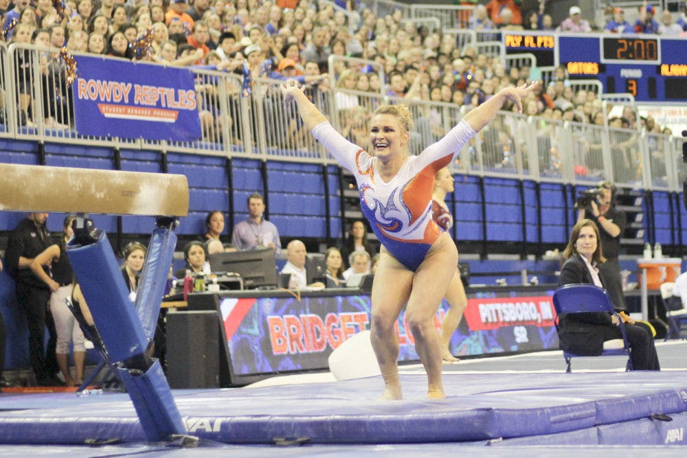 <p>Bridget Sloan sticks her landing after her dismount from the balance beam during Florida's win over Alabama on Jan. 28, 2016, in the O'Connell Center.</p>