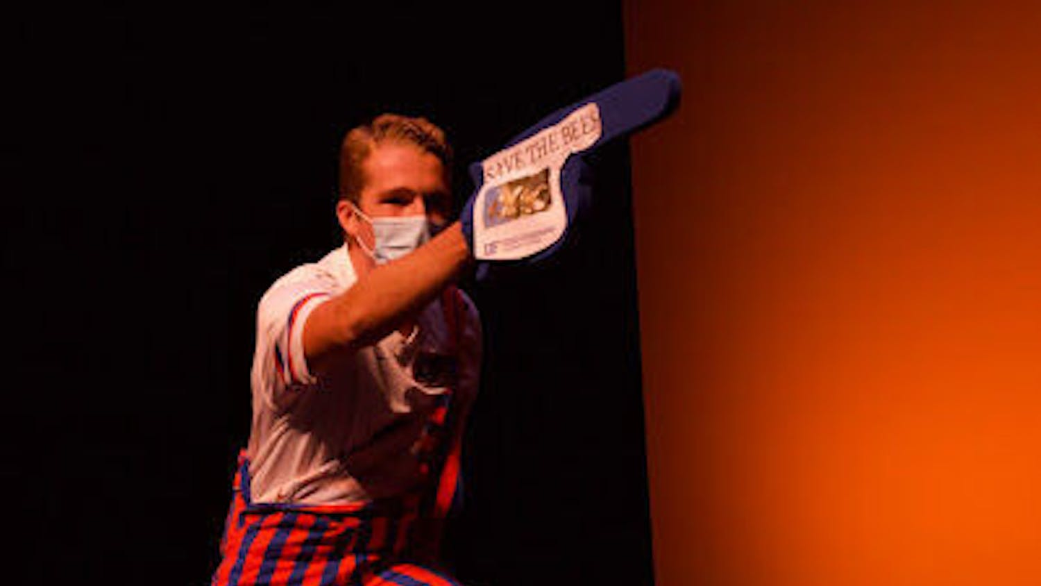 """Robert Shulte points a foam finger with the words """"save the bees"""" at the Homecoming Leadership Pageant.The pageant will air today at 7 p.m.(Photographer: Julia Quinn)"""
