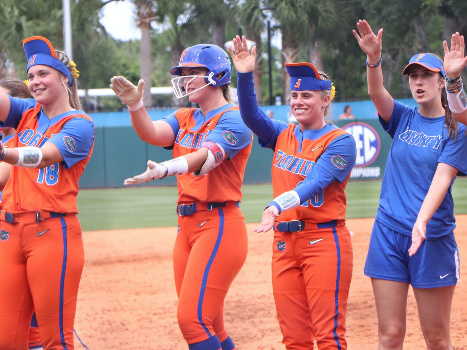 Members of the Florida softball team celebrate after a 1-0 victory over USF Friday