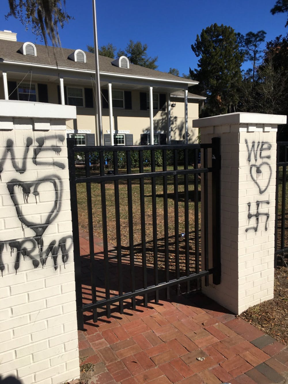 """<p><span>The UF chapter house of Delta Tau Delta was vandalized between <span class=""""aBn"""" data-term=""""goog_1056570203""""><span class=""""aQJ"""">Saturday</span></span> night and <span class=""""aBn"""" data-term=""""goog_1056570204""""><span class=""""aQJ"""">Sunday</span></span> morning.</span> <span>One column had a drawing of a heart over the swastika, another had a drawing of a heart over the word """"Trump"""" and the last had a drawing of a heart over the word """"rape.""""</span></p>"""