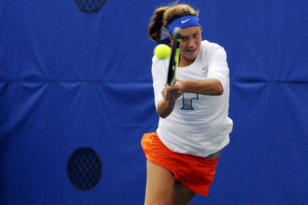 <p>UF's Anna Danilina returns a ball during Florida's 6-1 win over USF on Jan. 27, 2016, at the Ring Tennis Complex.</p>