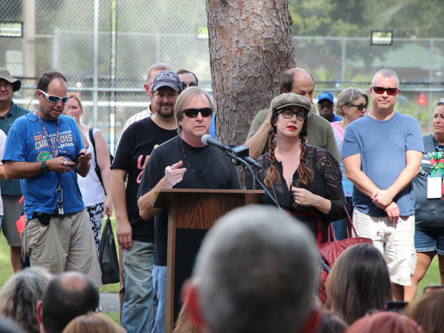 Tom Petty's brother and daughter, Bruce and Adria Petty stand behind the podium at the dedication of Tom Petty Park on Oct. 20, 2018. Both gave made statements and thanked the community before the unveiling of the new sign.