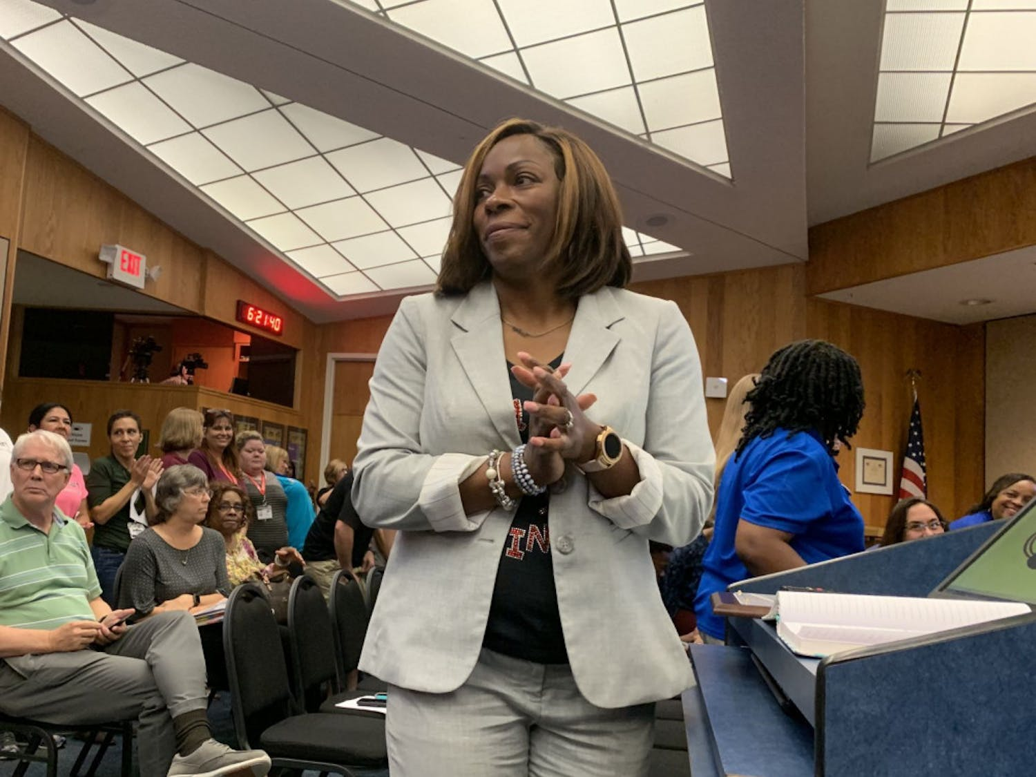 Natalie Strappy, executive director of the Alachua County School District's Head Start program, invites employees, parents and members of the program to stand and be recognized during a proclamation at Tuesday's school board meeting.
