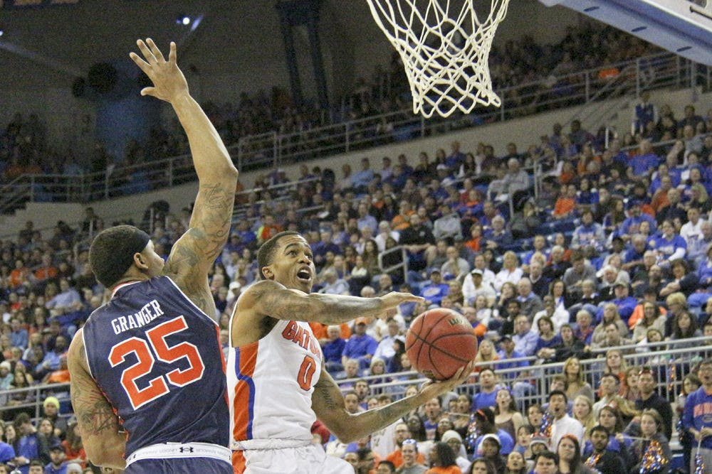 <p>Florida's Kasey Hill attempts a layup during UF's 95-63 win over Auburn on Jan. 23, 2016, in the O'Connell Center.</p>
