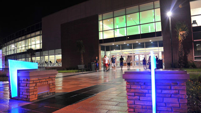 Students exit UF's Southwest Rec Center on a Sunday night.