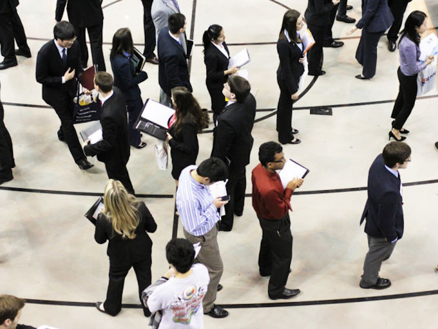 Students and alumni wait in line for the Career Showcase Non-Technical Day in the Stephen C. O'Connell Center on Tuesday. Technical Day, today, is from 9 a.m. to 3 p.m. for students majoring in engineering, biology, computer sciences and other technical fields.