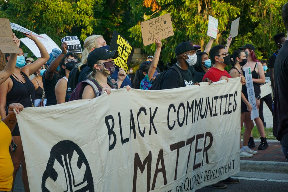 <p>Protestors march at a demonstration against building luxury student apartments on land located in in a historically Black community in Gainesville Thursday, June 18, 2020. The protest drew more than 300 people.</p>