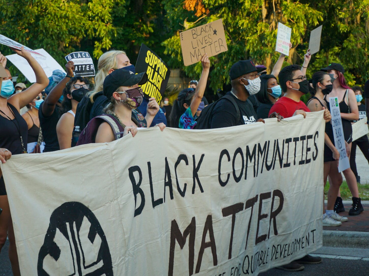 Protestors march at a demonstration against building luxury student apartments on land located in in a historically Black community in Gainesville Thursday, June 18, 2020. The protest drew more than 300 people.
