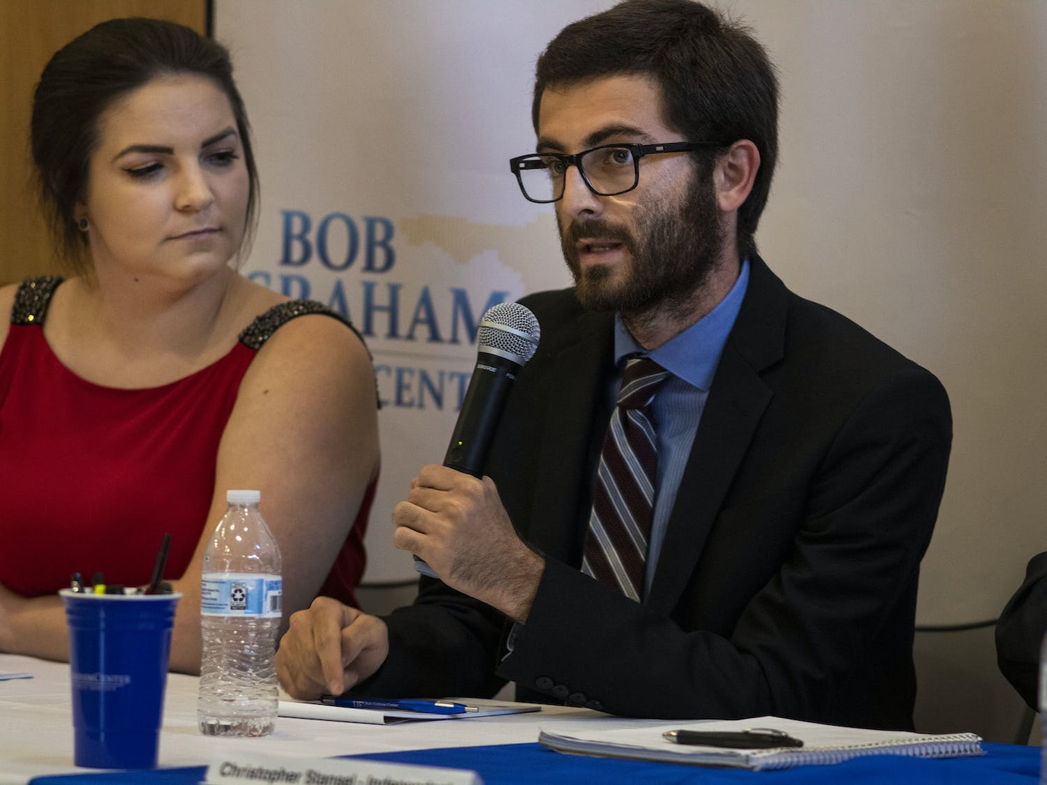 Inspire President Zachary Amrose (right) speaks at the debate Monday night. To his left sits Ashley Grabowski, former Inspire Senator and current Inspire Party campaign manager.