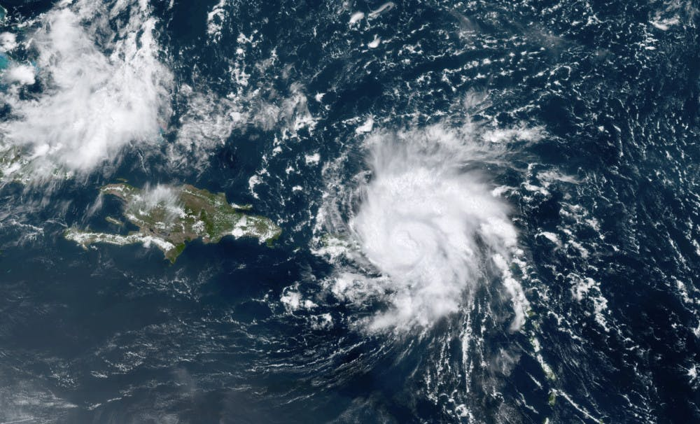 <p>This GOES-16 satellite image taken Wednesday, Aug. 28, 209, at 17:20 UTC and provided by National Oceanic and Atmospheric Administration (NOAA), shows Dorian, a Category 1 hurricane, crossing over the U.S. and British Virgin Islands. Forecasters say it could grow to Category 3 status as it nears the U.S. mainland as early as the weekend. (NOAA via AP)</p>