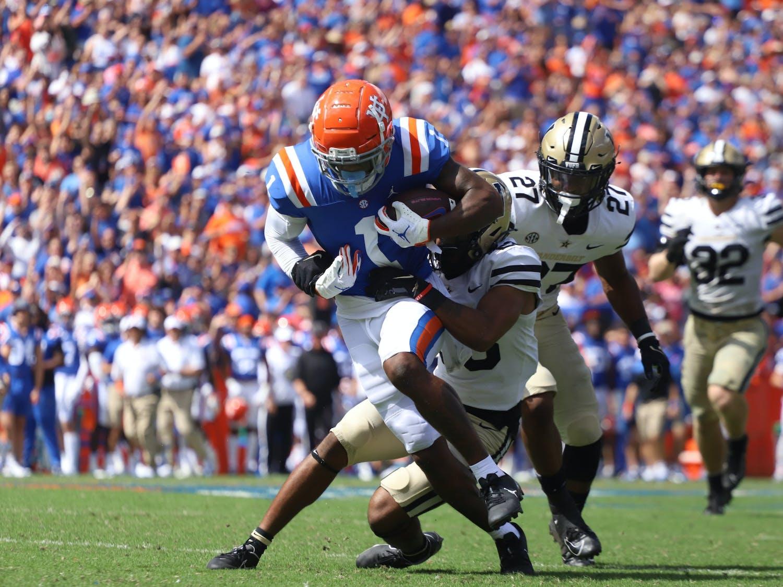Florida's Jacob Copeland fights off several Vanderbilt defenders during the Gators' 42-0 win on Oct. 9.