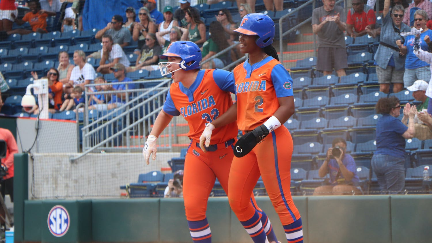 Florida's Kendyl Lindaman and Cheyenne Lindsey celebrate against South Florida on May 21. Lindaman and Lindsey combined for three hits and three RBIs in a 10-0 victory over South Alabama Saturday.