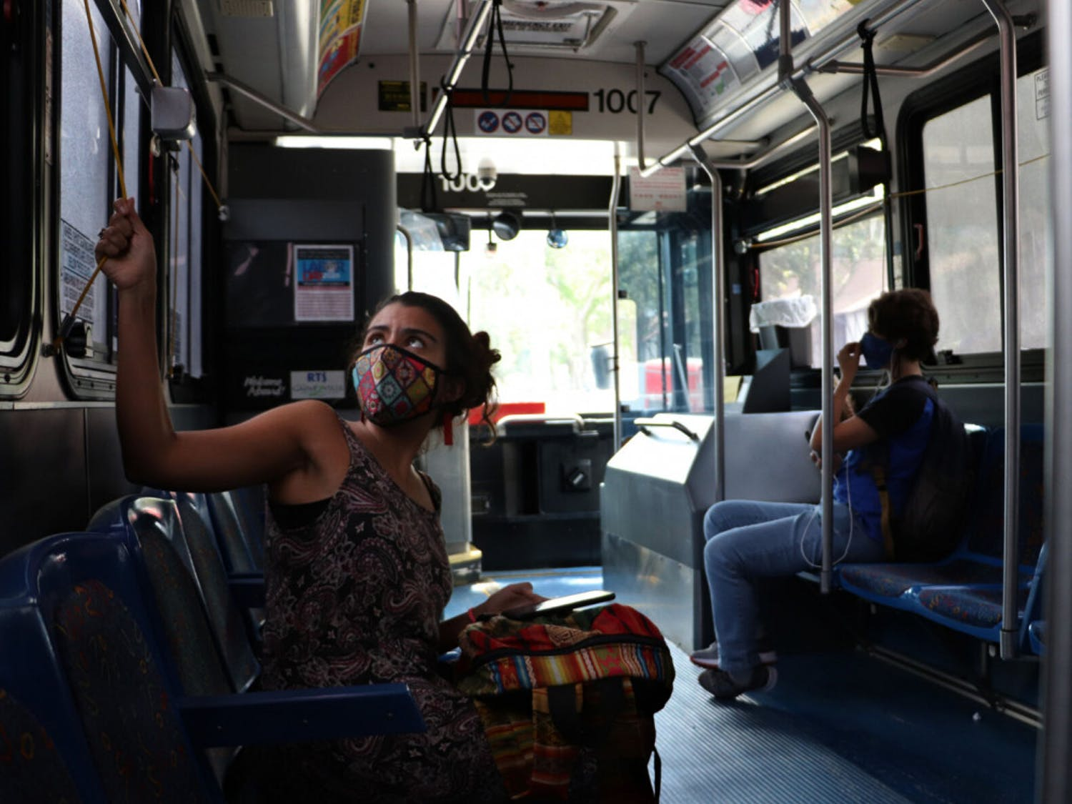 UF first-year interdisciplinary ecology PH.D. student, Natalia Uribe, 29, signals that she wants RTS bus No. 34 to make a stop on Wednesday, September 2, 2020.
