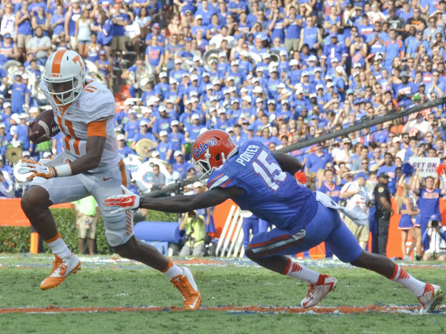UF defensive back Deiondre Porter misses a tackle on Tennessee quarterback Josh Dobbs during Florida's 28-27 win on Sept. 26, 2015, at Ben Hill Griffin Stadium.