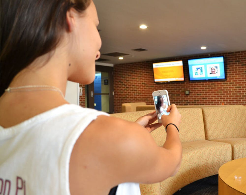 """<p class=""""p1""""><span class=""""s1"""">Emma Neagu, a 19-year-old UF telecommunication junior, takes a selfie using Snapchat on Thursday morning in Weimer Hall. The app is becoming a recruiting tool.</span></p>"""