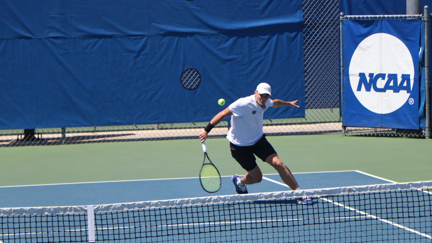 Florida's Sam Riffice returns a ball against South Florida on May 9th. Riffice advanced to the men's semifinal at the individual championships in Orlando, Florida on Wednesday.