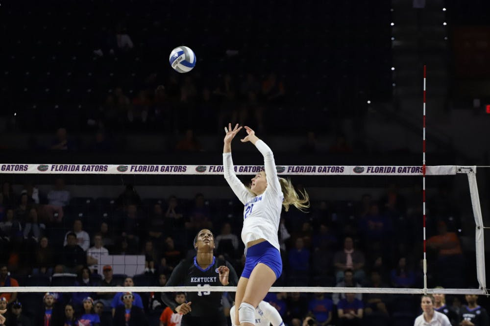 <p>Now-junior Marlie Monserez sets for the Gators at last year&#x27;s home match versus Kentucky. The setter reached a career-high in kills Friday against Tennessee</p>