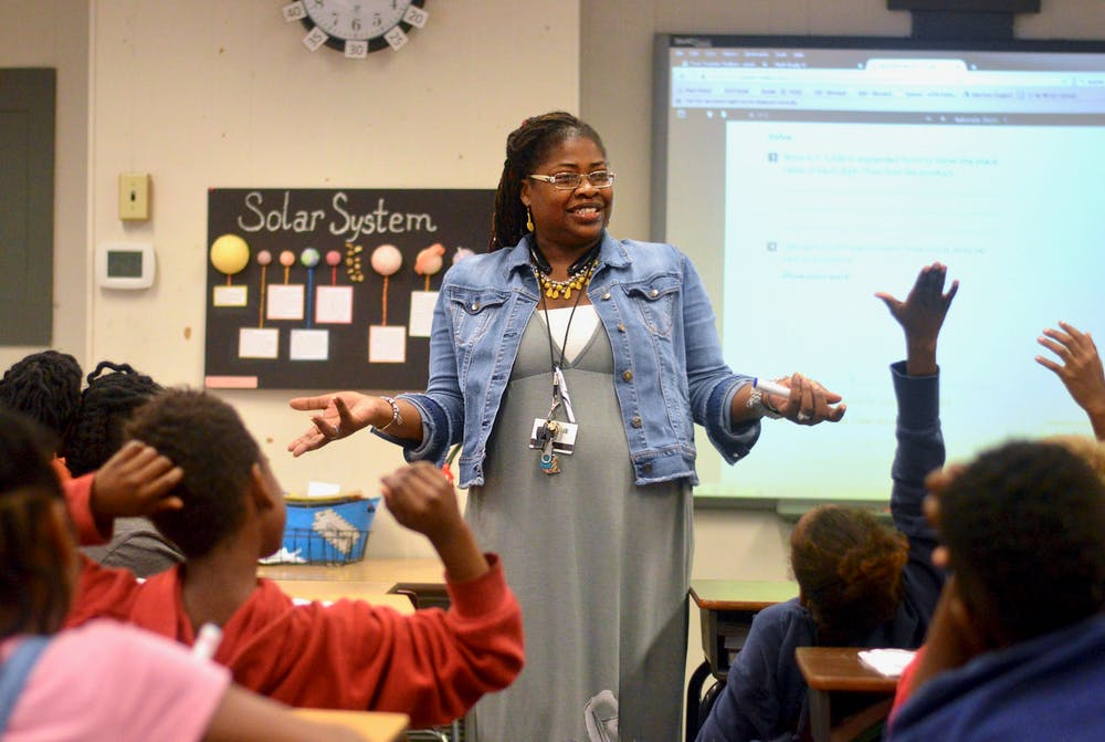 """<p dir=""""ltr""""><span>[FILE PHOTO] 35-year-old Lilliemarie Gore leads students of Idylwild Elementary School through a series of math exercises. Mrs. Gore was awarded the title of """"2017-2018 Alachua County Teacher of the Year"""" earlier this month.</span></p><p><span></span></p>"""