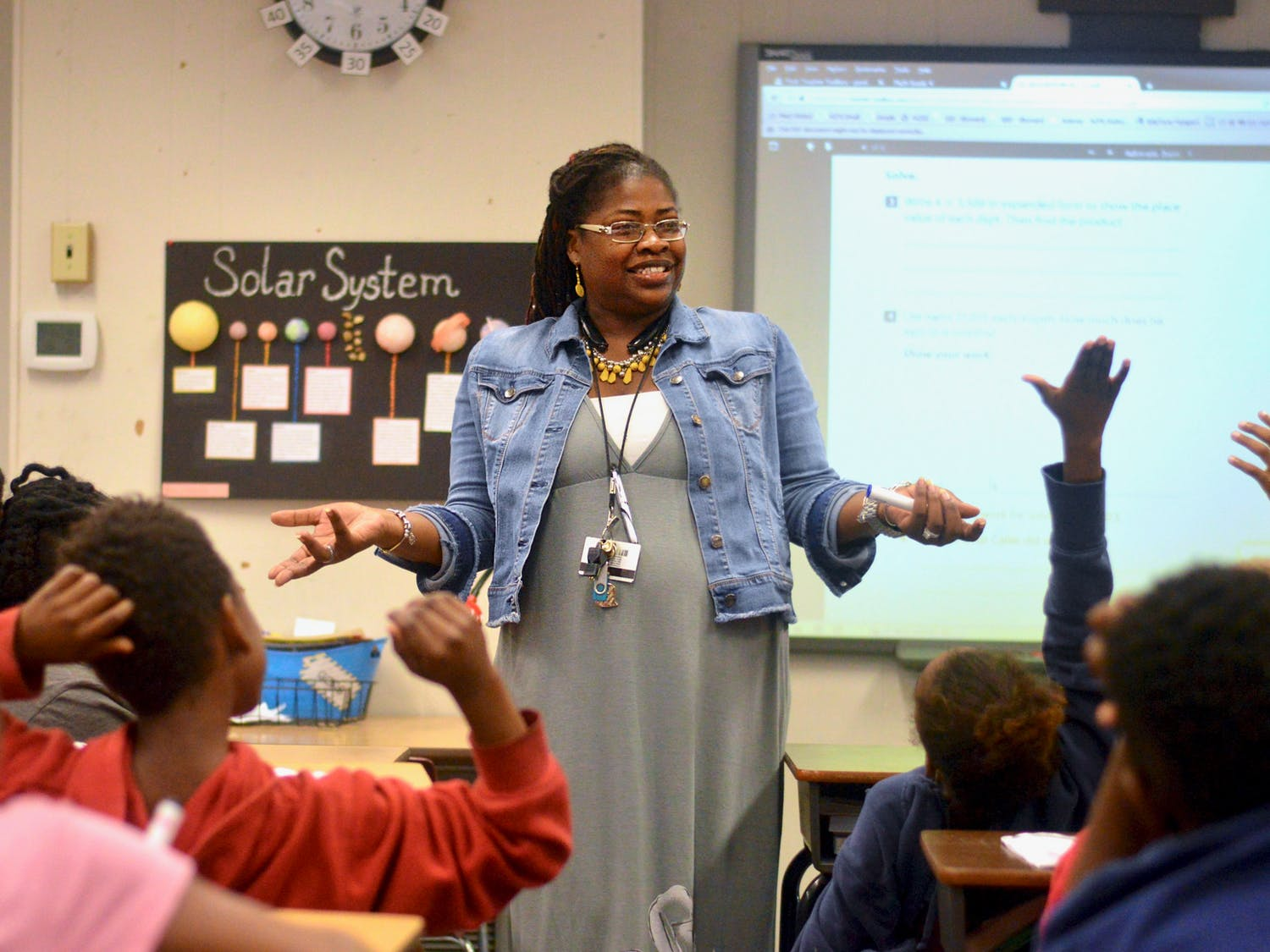 """[FILE PHOTO] 35-year-old Lilliemarie Gore leads students of Idylwild Elementary School through a series of math exercises. Mrs. Gore was awarded the title of """"2017-2018 Alachua County Teacher of the Year"""" earlier this month."""
