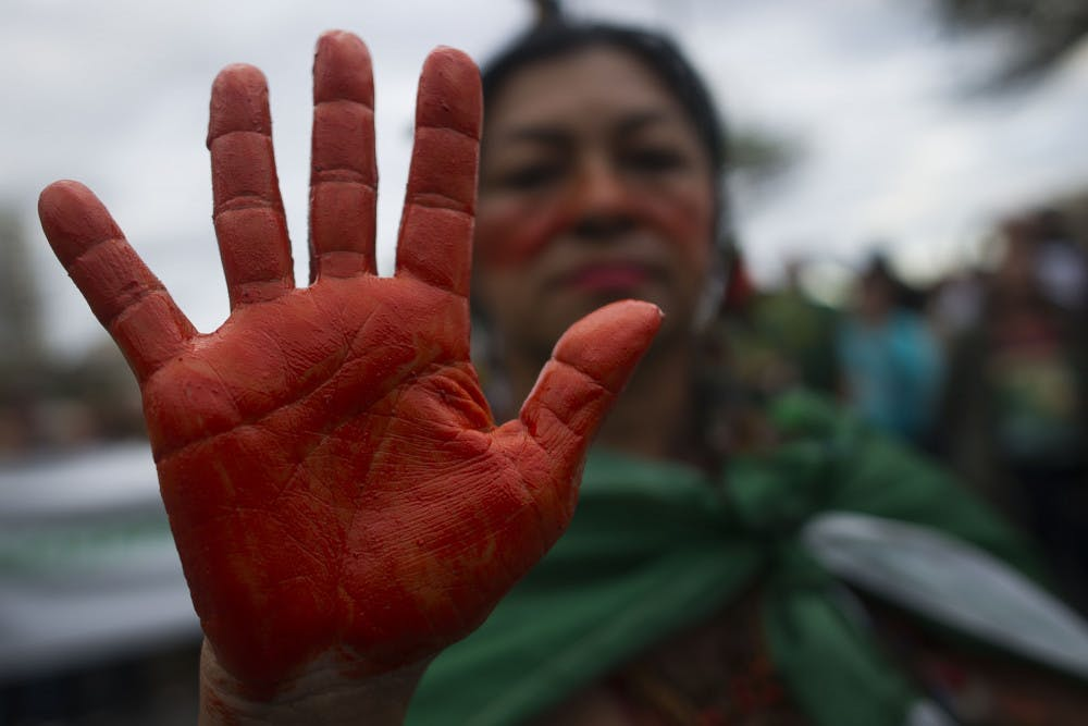 <p>An indigenous woman shows her hands painted in red, representing blood, during a protest in defense of the Amazon while wildfires burn in that region, in Rio de Janeiro, Brazil, Sunday, Aug, 25, 2019. Experts from the country's satellite monitoring agency say most of the fires are set by farmers or ranchers clearing existing farmland, but the same monitoring agency has reported a sharp increase in deforestation this year as well. (AP Photo/Bruna Prado)</p>