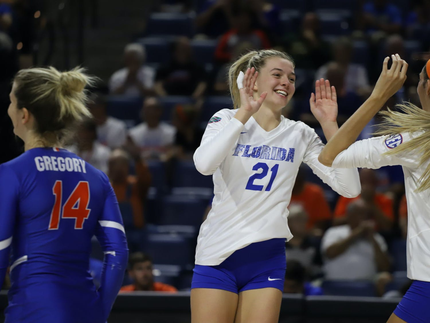 Florida's Marlie Monserez celebrates with her teammates during a game in 2019.