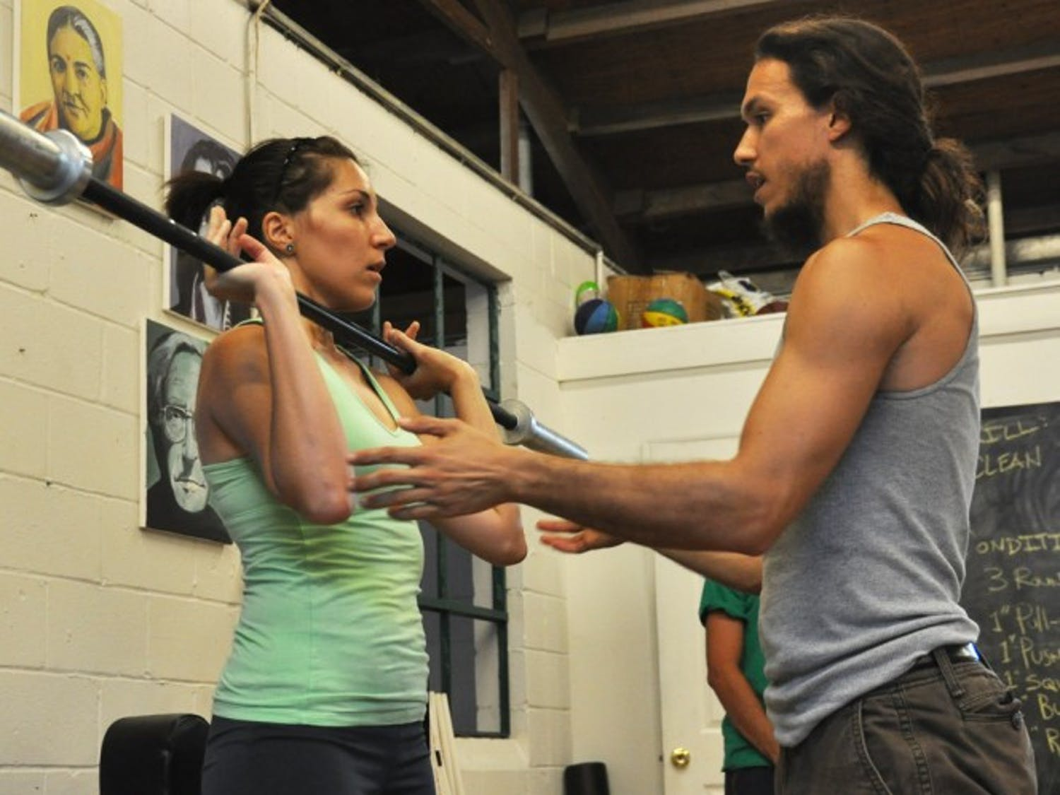 Maria Trujillo, a 25-year-old UF alumna, takes instruction from Michael Espinosa, a 27-year-old UF alumnus and founder of The Ark School of Fitness, 22 NE 11 St. The Ark gym is a nonprofit facility.