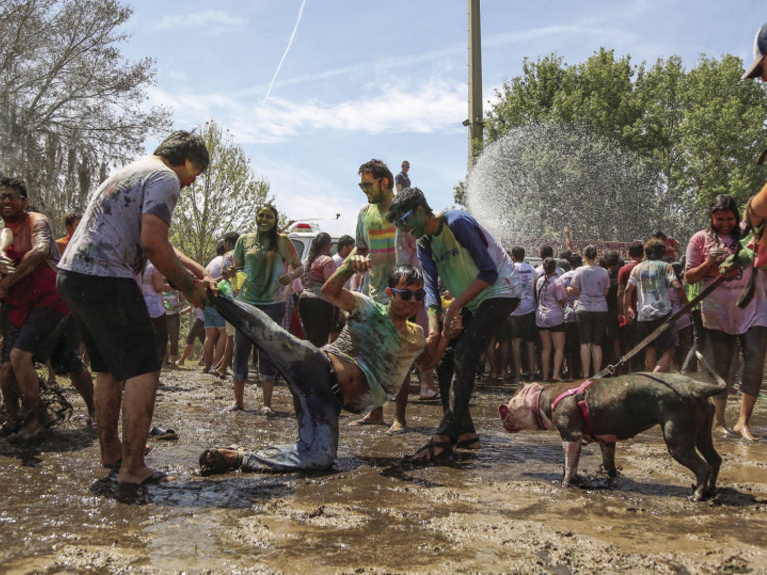 Participants of the 2017 UF Holi Festival of Colors, organized by the Indian Student Association and Student Government, have a mud fight on Sunday afternoon on Flavet Field. After the kickoff, people went under water thrown by a fire truck.