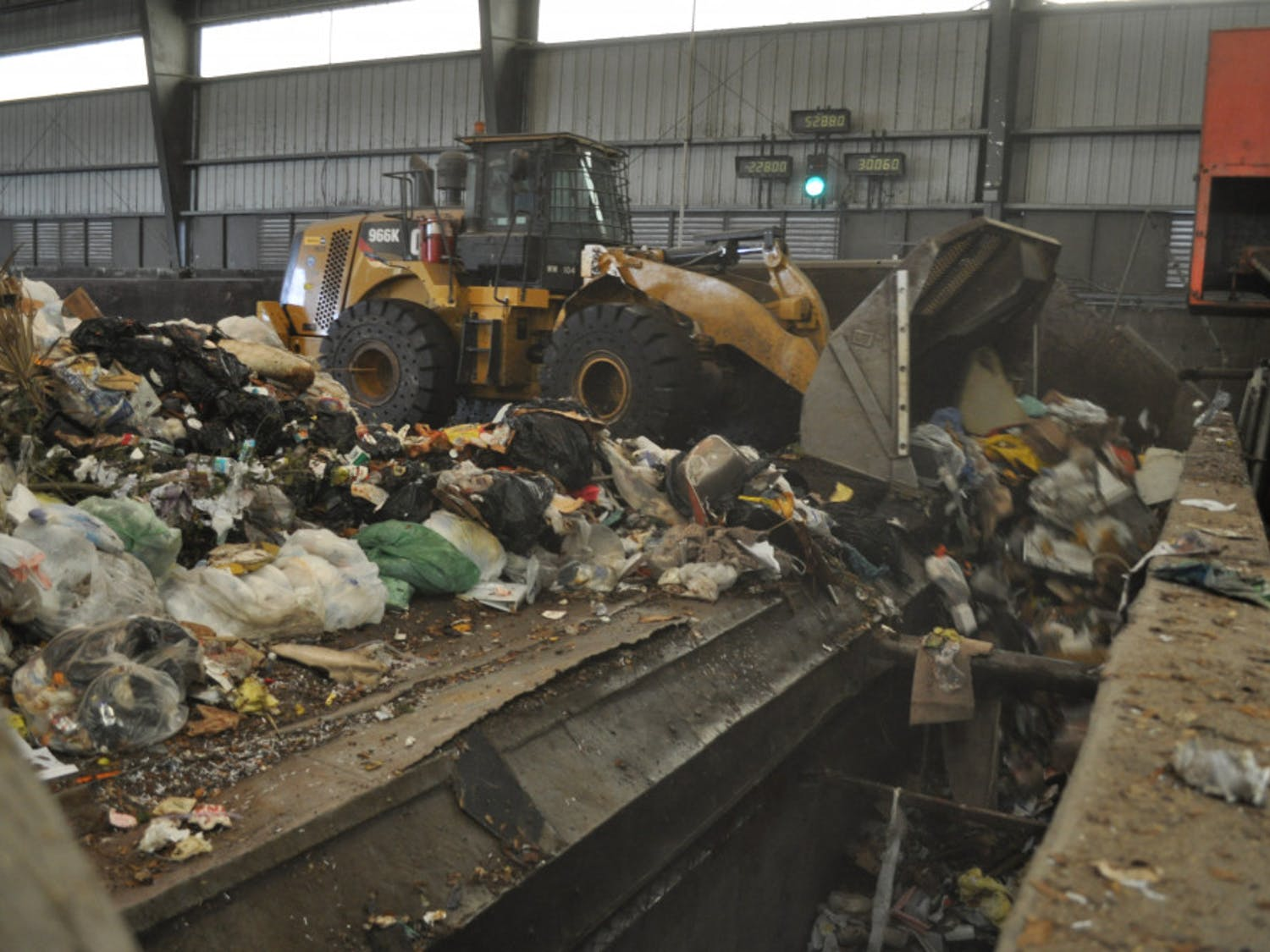 Photo caption: Waste gets pushed into trailers at Leveda Brown Environmental Park and will be transferred to New River landfill in Raiford.
