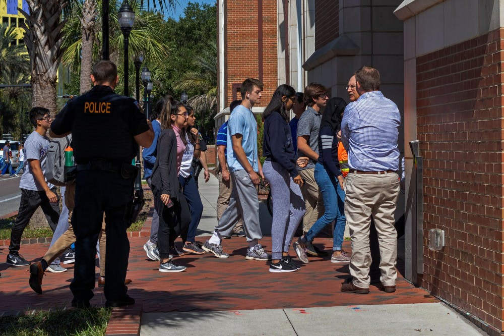 """<p><span id=""""docs-internal-guid-98bba7fd-7fff-4c6d-ecb4-0234c31e9052""""><span>Students head back into Hernandez Hall after the evacuation order was lifted from the building. The entire building was forced to evacuate Wednesday afternoon after multiple students reported feeling lightheaded.</span></span></p>"""