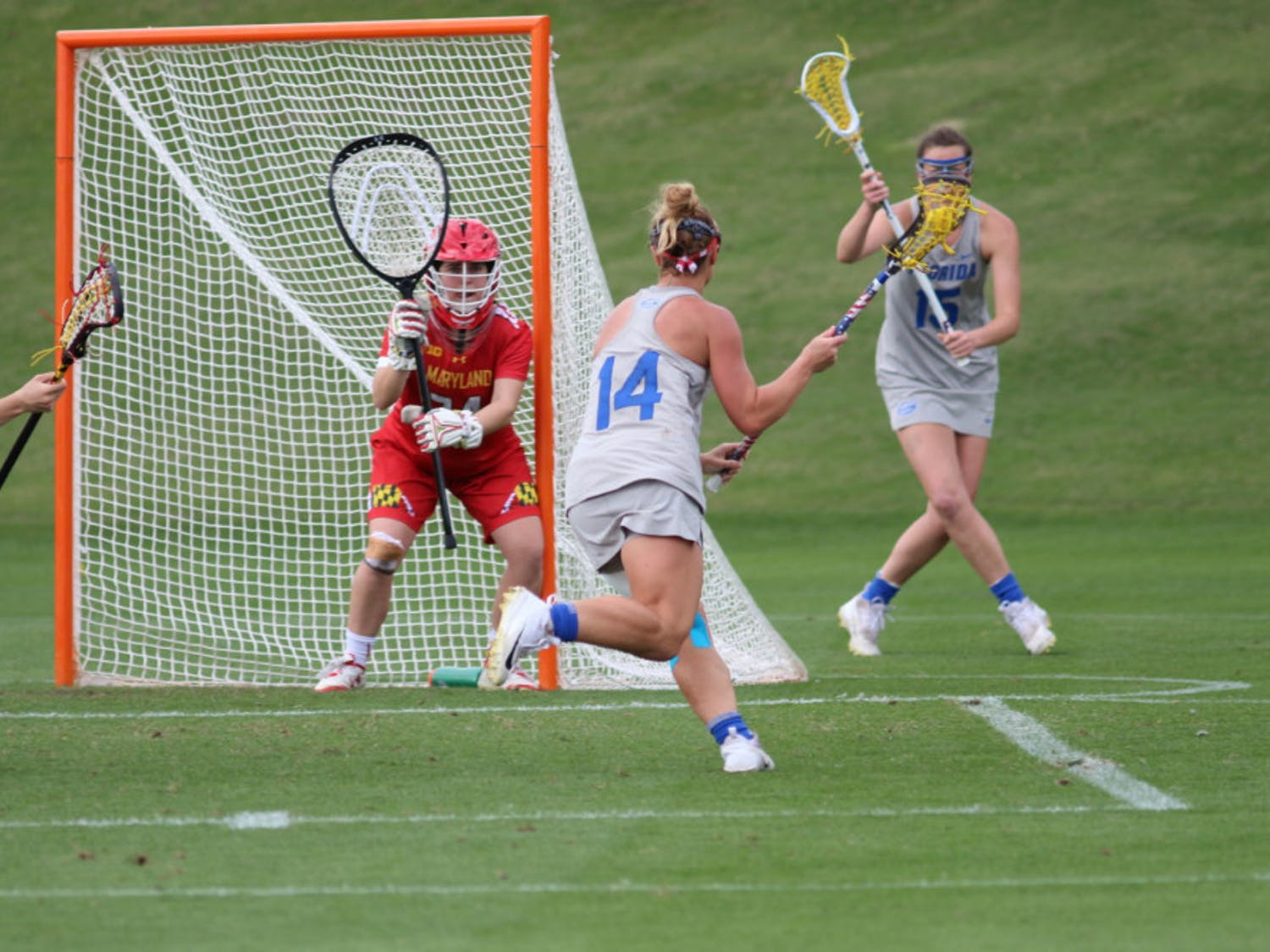 Lindsey Ronbeck scored five goals and one assist in the Florida lacrosse team's 32-1 win over Scotland on Saturday.
