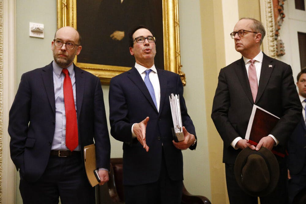 <p>Treasury Secretary Steve Mnuchin, center, speaks with members of the media as he departs a meeting with Senate Republicans on an economic lifeline for Americans affected by the coronavirus outbreak. on Capitol Hill in Washington, Monday, March 16, 2020. (AP Photo/Patrick Semansky)</p>