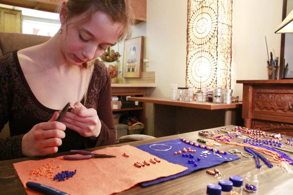 <p>Lisa Frimberger, a 21-year-old nursing sophomore, owns Gator Glass Jewelry line. Her jewelry is available at www.gatorglassjewelry.com or at Ilene's For Fashion, 2441 NW 43rd St.</p>