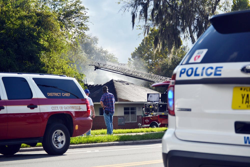 <p>Smoke rises from UF Keys Residential Complex after a fire started in the laundry room Sept. 19, 2015. According to UPD spokesman Maj. Brad Barber, a residential assistant called GFR around 4:30 p.m.</p>