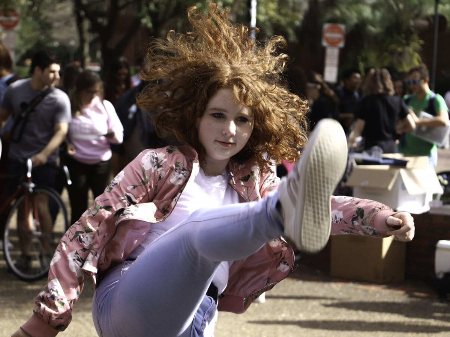 Genesis Dance Crew, UF's first K-pop cover group, performs in Turlington Plaza on Wednesday afternoon.