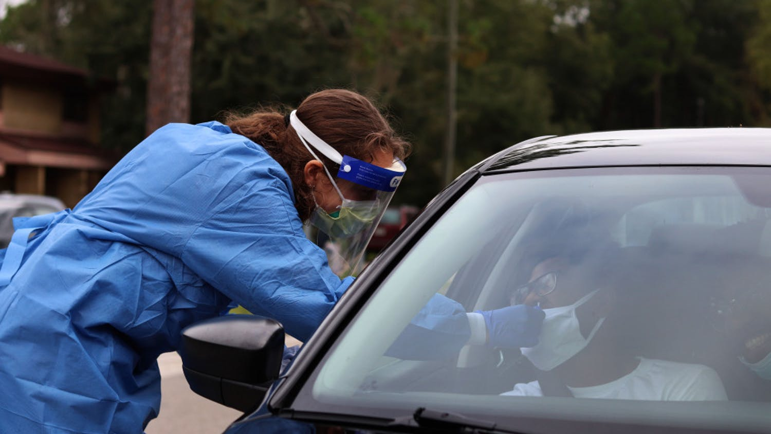 Hannah Lyons, 22, a UF first-year medical student, swabs a patient in the drive-through line in Gainesville, Fla., on Saturday, Sept. 19, 2020. UF Community Health and Family Medicine, SW Advocacy Group and the Alachua County Health Department teamed up to organize this free-testing event from 9a.m. - 1p.m. (Lauren Witte/Alligator Staff)
