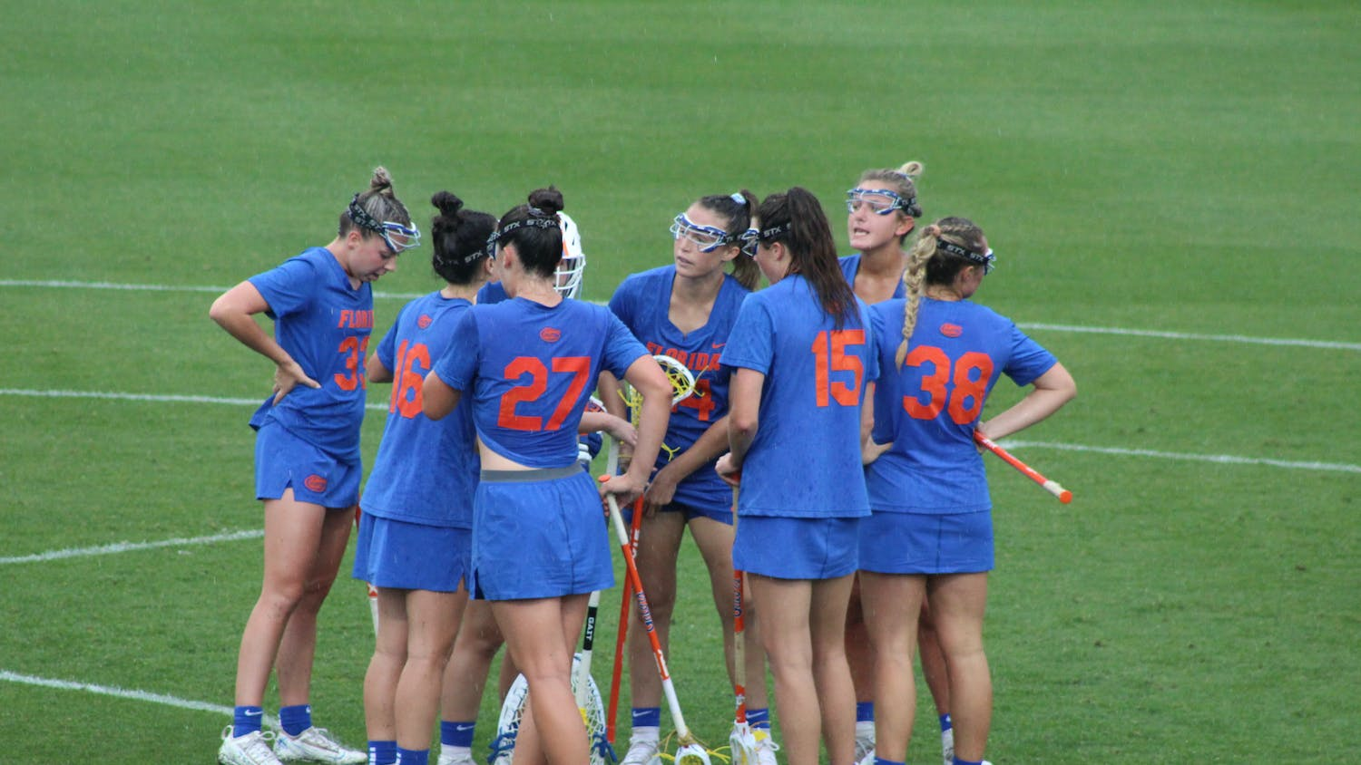 The Florida lacrosse team huddles against Vanderbilt on April 16. The team's season ended Saturday with a loss to Syracuse in the Elite Eight.