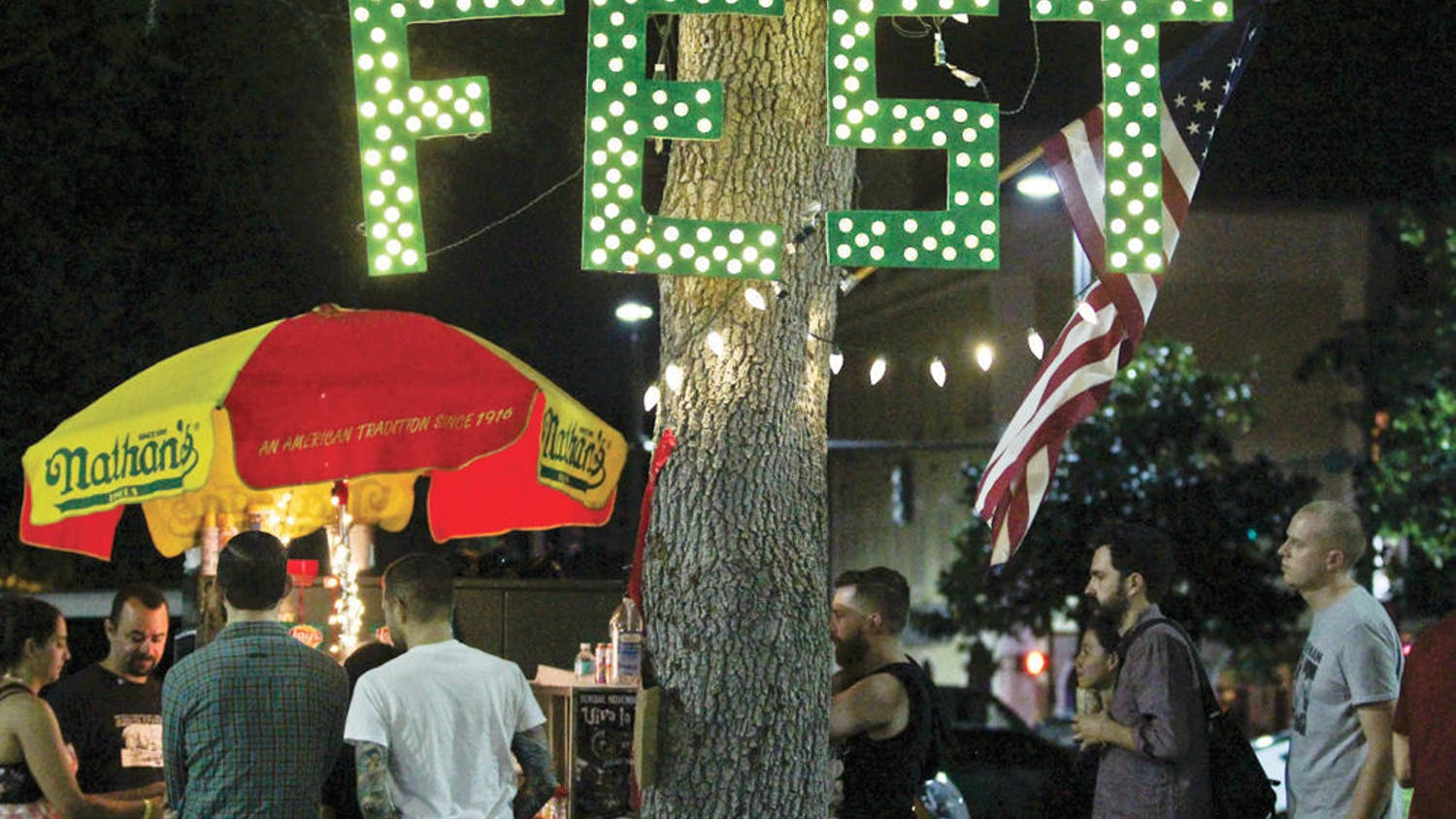 Festival-goers crowd a hot dog stand during FEST 14 on Oct. 31, 2015.