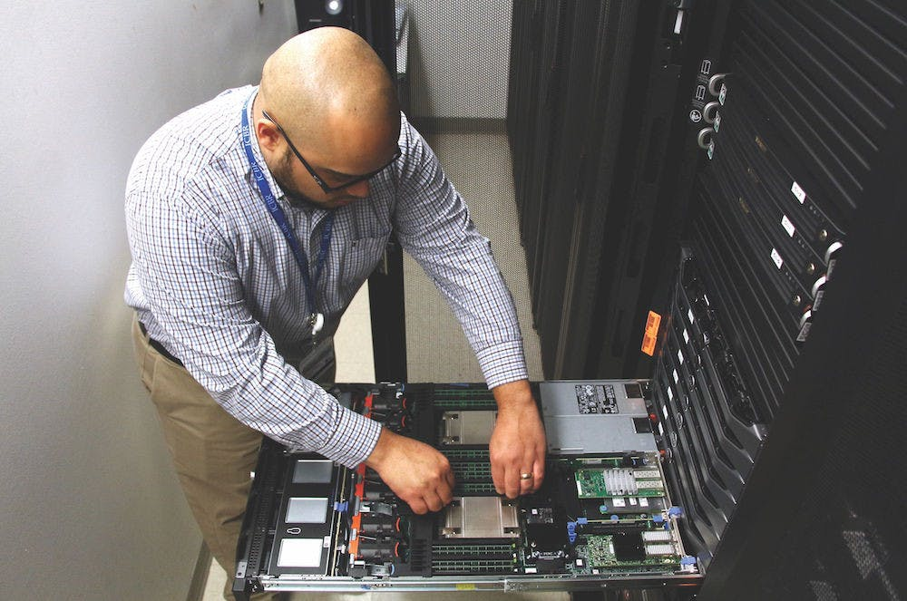 <p>Omar Lopez, a lead scientific systems developer with the UF Center for Biotechnology Research, is enrolled in UF's Employee Education Program, which allows full-time employees to take up to six credit hours tuition-free. Lopez, 25, hopes to get his associates degree by the end of the year.</p>