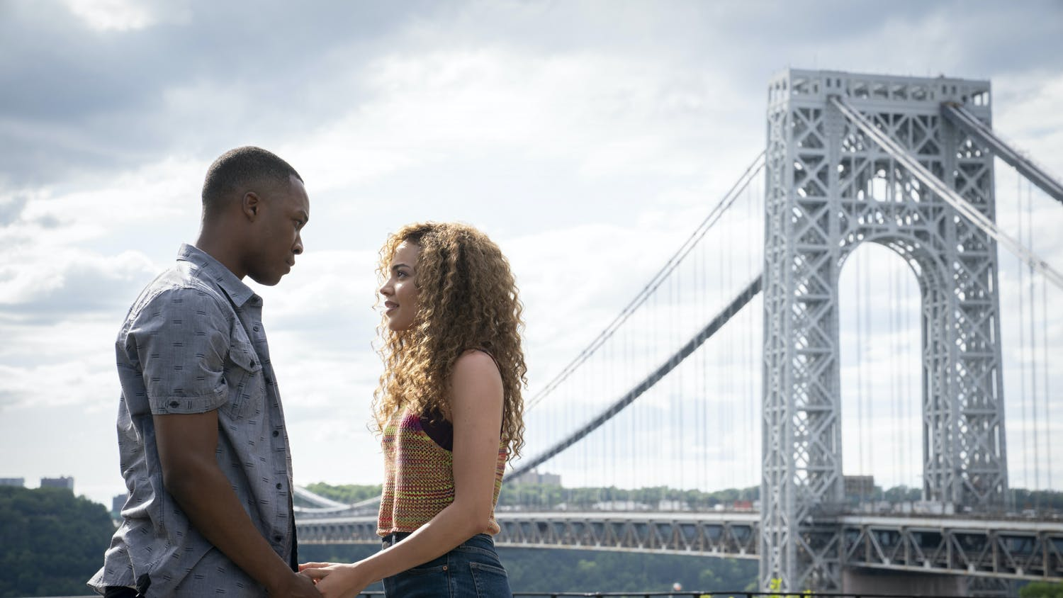 """This image released by Warner Bros. Entertainment shows Corey Hawkins, left, and Leslie Grace in a scene from """"In the Heights.""""   (Macall Polay/Warner Bros. Entertainment via AP)"""