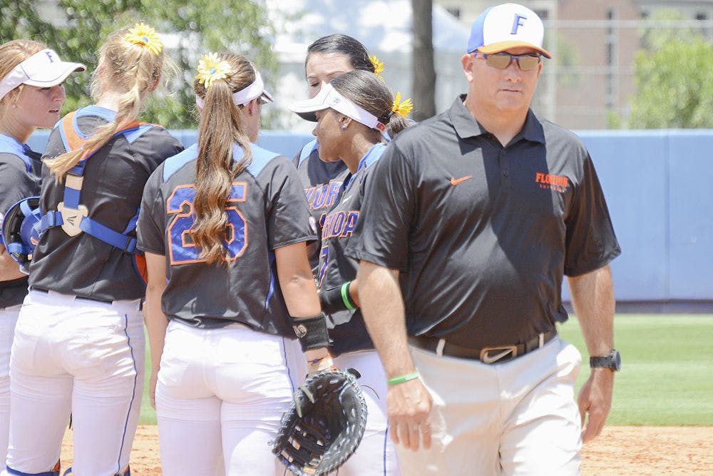 <p>Coach Tim Walton walks back to the dugout during Florida's 1-0 win over Florida Atlantic on May 17, 2015, at Katie Seashole Pressly Stadium.</p>