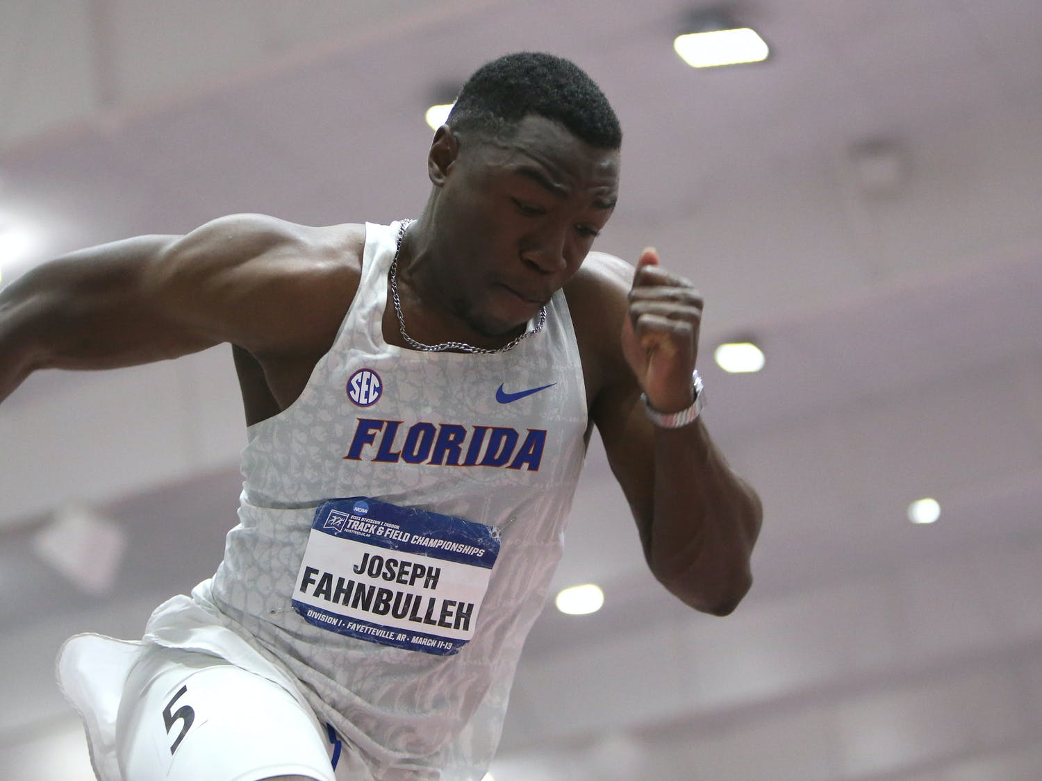 Florida's Joseph Fahnbulleh competes during the third day at the NCAA Indoor Championships on Saturday, March 13, 2021 at Randal Tyson Track Center in Fayetteville, Ark. / UAA Communications photo by Rick Hurtado