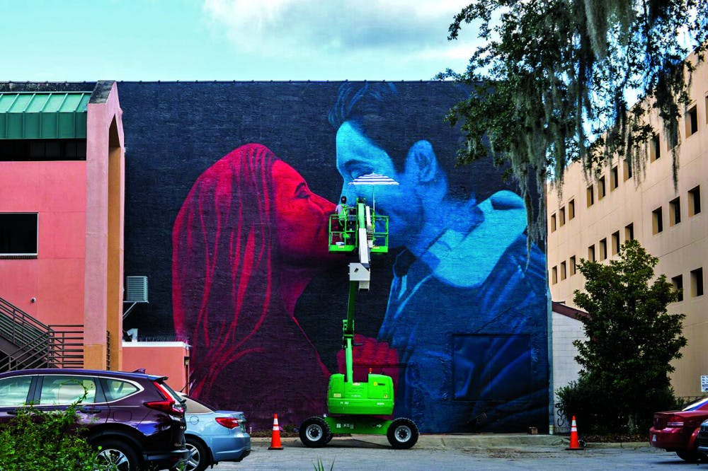 """<p><span id=""""docs-internal-guid-c55a5dbd-7fff-9f5f-6cb9-3a3929952457""""><span>The 3D art mural at the wall behind the Florida Theatre on West University Avenue was revealed Sunday afternoon. It cost $10,000 to pay for the materials and the artist to fly in from Greece.</span></span></p>"""