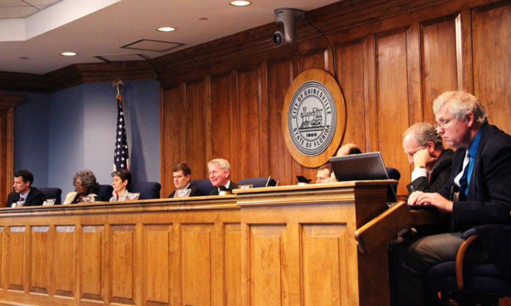 <p>Gainesville City Commissioners discuss the current neighborhood parking decal system Thursday. They unanimously passed a resolution to explore options of raising parking permit prices.</p>