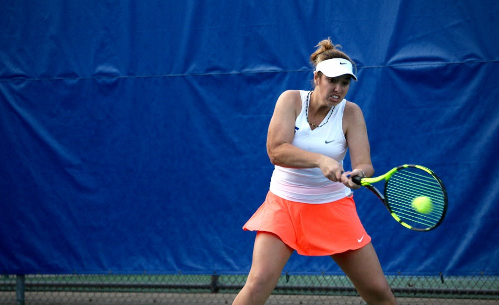 """<p class=""""cutlineGeneral"""">Brooke Austin hits a backhand during Florida's 4-2 win against Oklahoma State on Feb. 18, 2017, at the Ring Tennis Complex.</p>"""