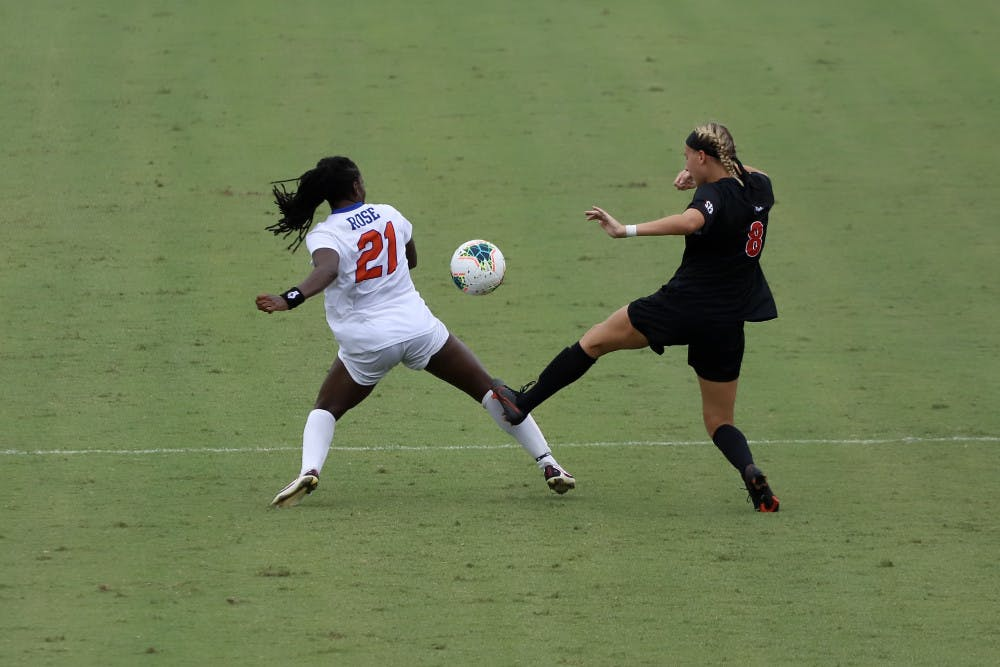 <p>Forward Deanne Rose fights for a ball at Florida's game against Georgia earlier this season. The senior's return will be a key factor in the Gators' game against South Carolina Sunday.</p>