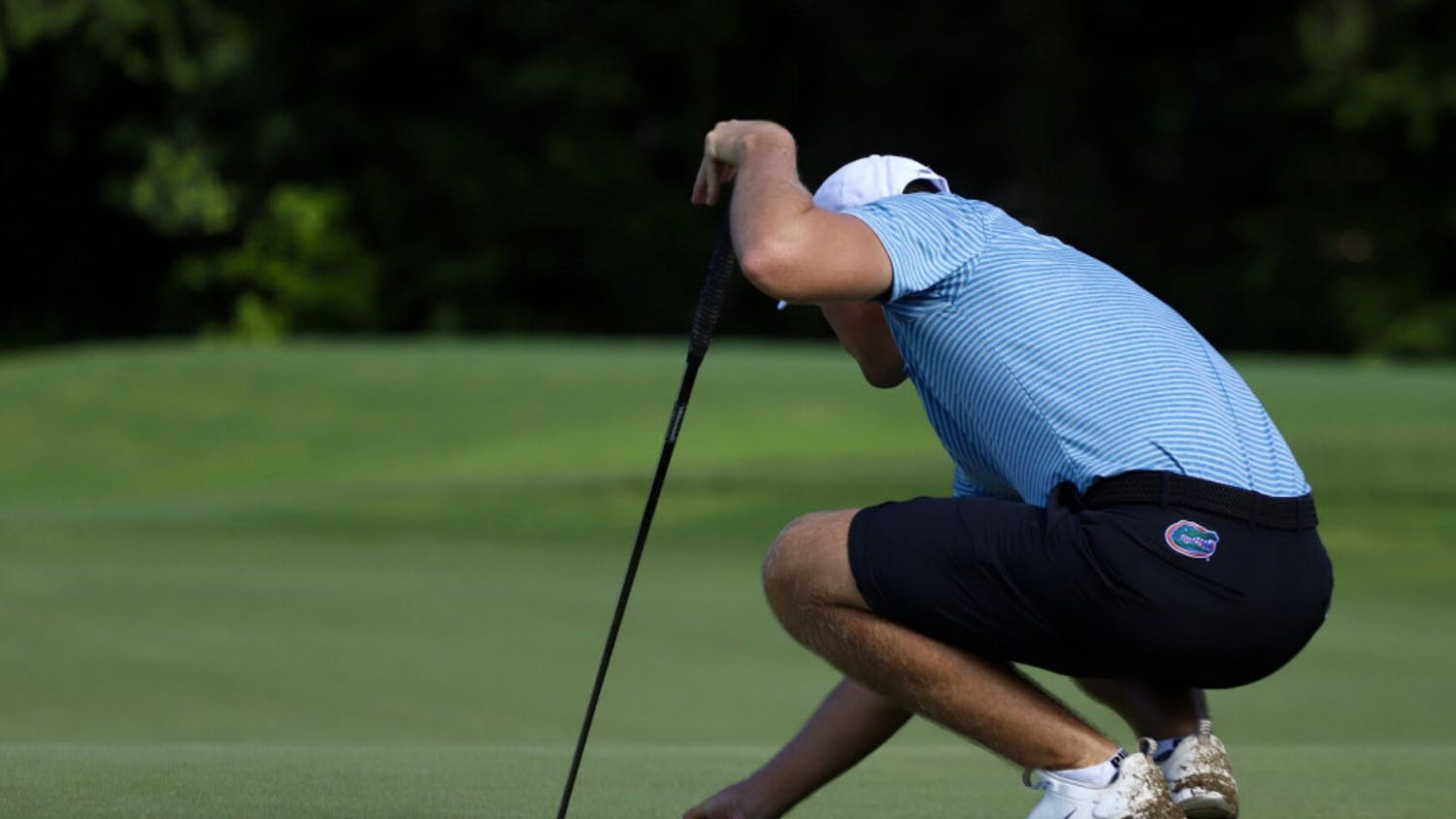 Florida's Joe Pagdin reads a putt at Mark Bostick Golf Course in Gainesville, Florida. Pagdin was one of four underclassmen to play in every spring tournament for the Gators and the SEC Freshman of the Year highlights the team's youth.