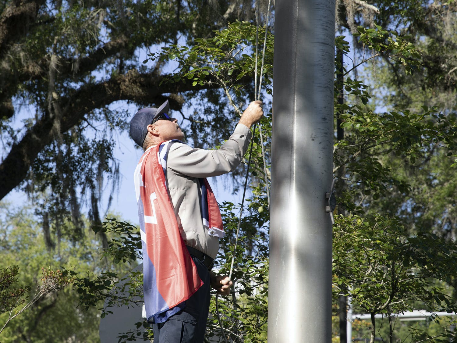 George Cannon, a supervisor of the Gainesville downtown area, raises the Juneteenth flag on Thursday, May 20, 2021.