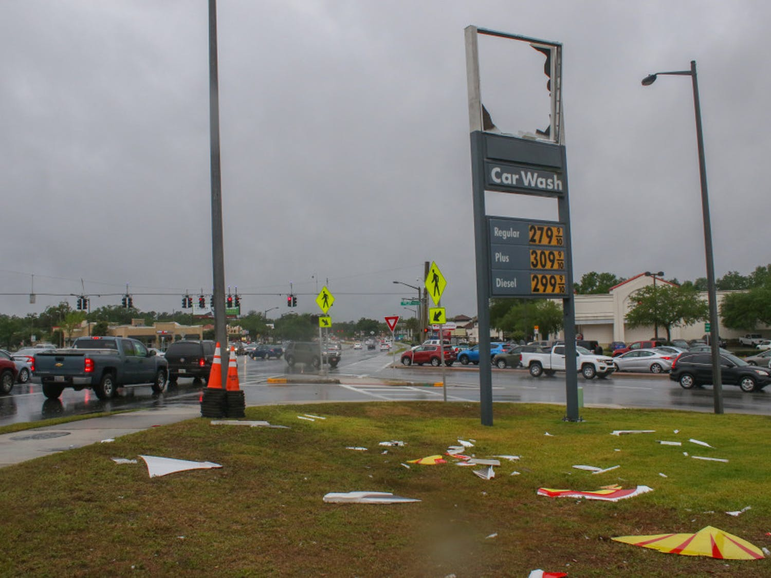"""The Shell sign is scattered across the ground Friday after strong winds blew it down during a storm at the Shell gas station, 3330 SW Archer Road. Daphne Roberson, an employee at the station, said she saw the sign go down around 11 a.m. """"It just all of a sudden happened,"""" she said. """"I looked up and it was flying across the air."""""""