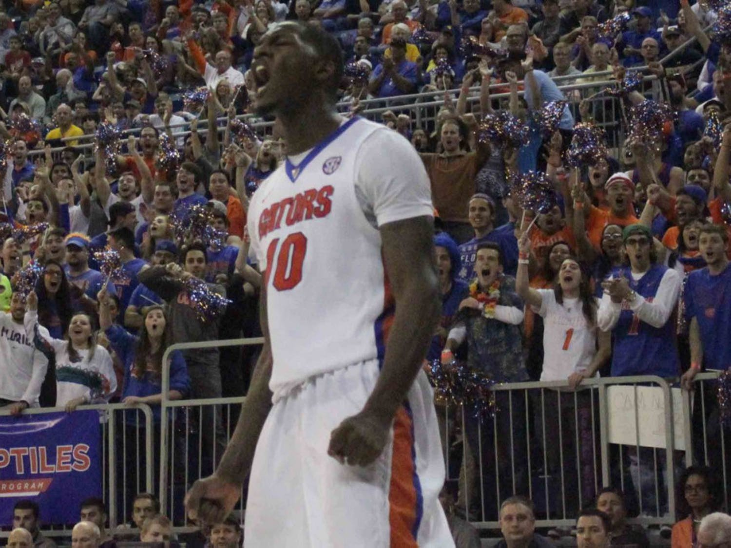 Dorian Finney-Smith screams after a dunk during Florida's win over West Virginia on Jan. 30, 2016, in the O'Connell Center.